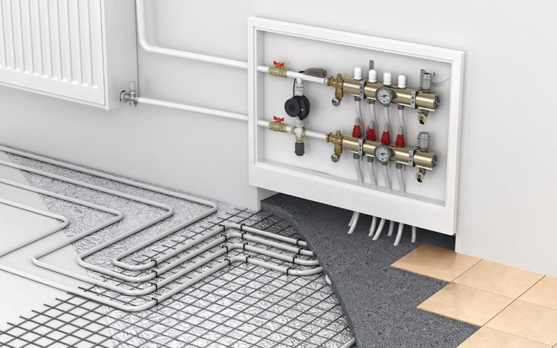 underfloor heating with collector and radiator in the room concept of technology heating the